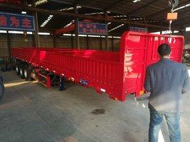 标箱侧翻自重6.8吨包拉50吨自卸半挂车
