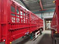 11米侧翻自卸半挂车集装箱式半挂车图片